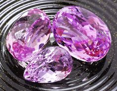 Lot of large Kunzite gemstones from Afghanistan. Kunzite is the pink to light purple gem variety of the mineral Spodumene. It is a relatively inexpensive gemstone so there is no real incentive to produce a synthetic version. The color of kunzite is distinctive and there are a few other gemstones that it could be confused with.