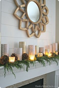 Elegant Christmas mantel---A CHEAP way to get a high end and elegant look! Wrap candles, fake & real, glassware from the dollar store, and votive's with scrapbook paper or gift wrap. <<Love>>