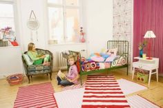 layering rugs and green bed for kids room