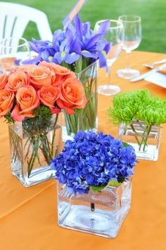 Simple center pieces...get these vases and put lemons in them then flowers