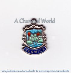 Vintage Enamel Sterling Silver Keswick England Shield Charm - $18.95  This vintage shield charm is for Keswick, a market town located near the Lake District National Park in England. It features an extremely vibrant rendition of the local scenery. The charm enamel on sterling silver, measures roughly 5/8 inch x 7/16 inch and is excellent vintage condition with very minor signs of wear.  http://www.ebay.com/itm/260960644979