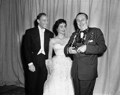 Walt Disney con Elizabeth Taylor e il marito dell'attrice, Michael Wilding
