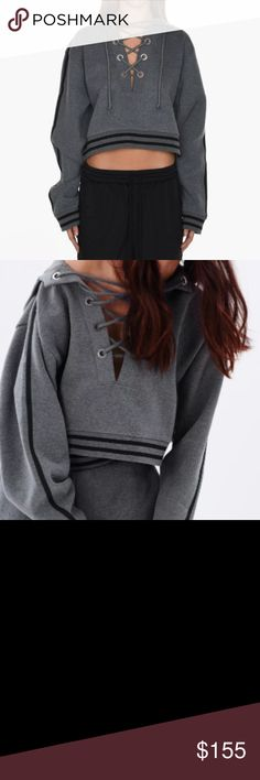 NWT Rihanna X PUMA Rising Sun Lacing Sweatshirt The FENTY PUMA by Rihanna Rising Sun Lacing Sweatshirt features the Japanese red sun motif and stylized PUMA branding at the back. It's laced at the front with a thick, knotted rope through oversized eyelets with FENTY and PUMA embossing. Puma Tops Sweatshirts & Hoodies