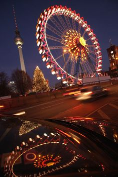 The Christmas market at Alexanderplatz against a backdrop of the Television Tower, former emblem of East Berlin.
