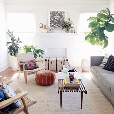 Drooling over this bright + fresh living room from @monicawangphoto  mud cloth pillows, a leather Moroccan pouf, a Berber pillow over on that far chair- my absolute fave ✨  We promise there is a restock of poufs and pillows coming veeeeery soon! Bare with us just another week or two as we are finishing renovations in the studio and trying to manage the madness
