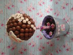 Delicious Maltesers sweet tree dressed with edible flowers and personalised butterfly.