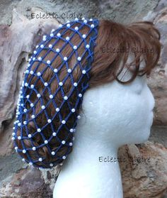 This snood is made and is ready to go! This snood hairnet is made from #10 navy blue cotton crochet thread and there are a ba-zillion pearl beads throughout the netting. A smaller pearl is used in the center of the snood. The size of the pearl increases to a larger bead throughout most