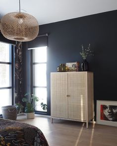 my scandinavian home: Dark blue walls and rattan in a Finnish bedroom