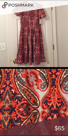 Brand New Amelia Gorgeous spring print! Light blue background with a blue, orange, and white design. I wanted to love it, but the orange didn't work with my hair color. Perfect condition, tags still attached. Would be perfect as an Easter dress! LuLaRoe Dresses