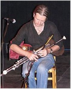 The traditional Irish Uilleann Pipes...or elbow pipes...differ from the more familiar Scottish...Great Highland...bagpipes in a number of ways....