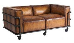 Photo de canapé cuir sur roulette avec des bout de tuyaux assemblés → touslescanapes.com
