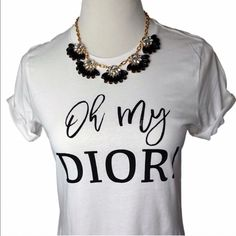 "Oh my Dior Graphic Tee Make a statement with this soft 100% cotton tshirt that reads ""Oh my Dior"" perfect to pair with jeans, heels and a black blazer or dress it down by itself and your favorite pants. Small (2-4) Medium (6-8) Large (10-12) cuff the sleeves or leave them plain. Price is firm unless bundled. Retails for $40 everywhere. Get them here for less  iconiclegend Tops"