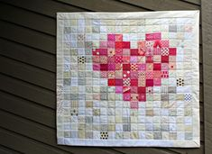 New arrivals in our extended family means baby quilts are definitely in order, and admittedly, I've gotten a very late start. But with this pixelated heart quilt, one can be on its way. The pattern i