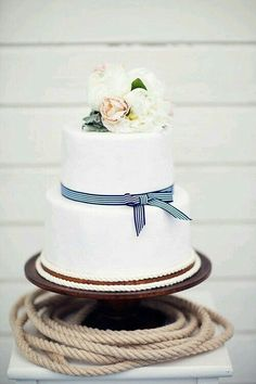 A chic nautical seaside wedding shoot in gorgeous fine art style with preppy blue stripes, blush flowers, and preppy striped details with nautical rope! Nautical Wedding Cakes, Nautical Cake, Summer Wedding Cakes, Seaside Wedding, Mod Wedding, Dream Wedding, Nautical Theme, Preppy Wedding Theme, Chic Wedding