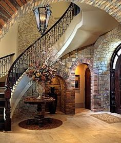 Art railing +interior stone + light fixture + dark wood. Just need a dark floor. castle-stuff