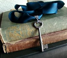 skeleton key, ribbon and book