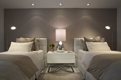 simple contemporary bedroom with pretty lighting and gorgeous taupe feature wall -Image 5 of 15