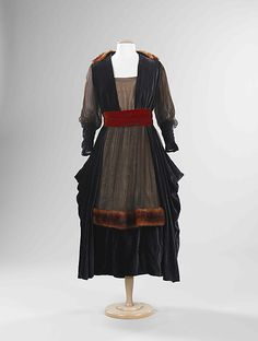 This evening dress by Marguerite reflects the transitional period around 1915 when dressmaking included a mix of materials. Here chiffon, fur, and velvet are used. The silhouette shows the popular pannier shape of the time. Although a variety of textiles were employed, the design is less complex than the embellished work of the Belle Époque. Via MMA.