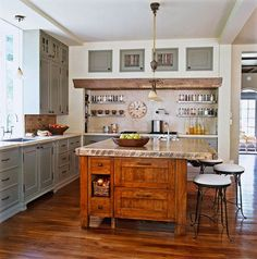 Slices of wood stained in subtly different hues are grouted like tile for the range backsplash. - Traditional Home ®/ Photo: Gordon Beall / Design: Diane Kahn
