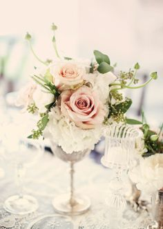 I could use my goblet set to make similar arrangements. I think they would be the perfect size for our small tables:)