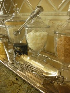 Apothocary Jar and Mismatched Silver Display - this makes a perfect coffee or tea station - via Trouvais