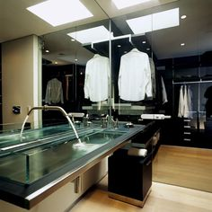 man bathroom/closet. Don't know how I feel about my closet in the bathroom but I can see how it would work