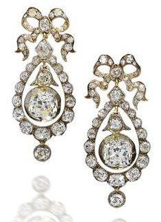 A pair of 19th century diamond pendent earrings. Each bow surmount suspending a pear-shaped drop, with diamond swing centre and finial, set throughout with old brilliant and cushion-shaped diamonds, mounted in silver and gold, principal diamonds approximately 1.65 and 1.75 carats, remaining diamonds approximately 2.00 carats total.