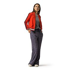 Tommy Hilfiger women's jacket. Taking a page from the air force, we combined our signature sporting roots to bring you a more eye-catching version of the classic original. It's a perfect this-season-to-that-season topper that will go, well, at the speed of sound. <br>• Classic fit<br>• 92% synthetic, 8% elastane. <br>• Zip closure, exterior pockets.<br>• Machine washable.<br>• Imported.<br>