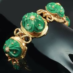 Russian articulated bracelet with carved, domed malachite, 18kt gold and seed pearls, circa 1820-1830.