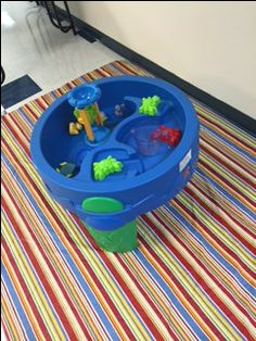 Water table that we set up to allow children to play in the water and learn pouring skills.