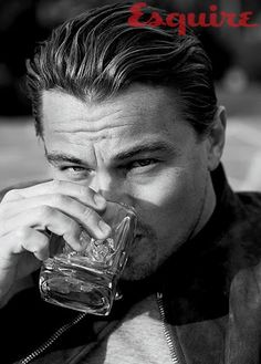 leo dicaprio having a drink on the rocks