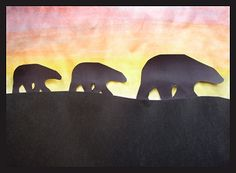 construction paper polar bears over watercoloured northern lights