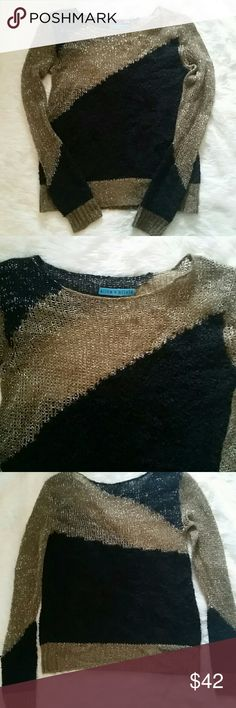 Alice + Olivia sweater Black and tan sweater with silver metallic from Alice + Olivia.  Worn but in great condition.  This does not fit me so I cannot model. Alice + Olivia Sweaters