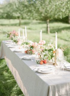 Tablescape with grey linens and peach florals via Wedding Sparrow blog www.weddingsparrow.com
