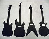 """Metal Wall Art Decor Set Of 4 Guitars,   Made from High Quality Steel, Painted Black, In New Condition,  Each Guitar Measures Aproximately 16"""" Long By 5"""" Wide."""