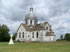 (Near Mundare, Alberta 2009) Spaca Moskalyk Ukrainian Catholic Church and cemetery (also known as Transfiguration of our Lord) in Lamont County, Alberta as seen in June 2009. Built 1924. (on Range Road 160 about 500 m. south of Township Road 540 [30])  (In February 2013, I read of plans to burn this prairie icon. I imagine that most of these old prairie churches will be gone within a decade or two) Photo: Gregory Melle