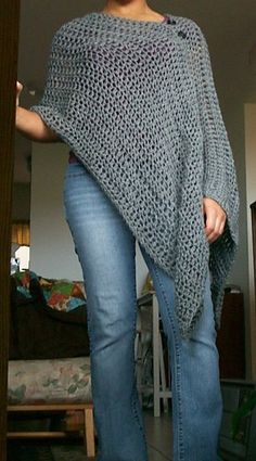 Crochet rectangular shawl, join partway on edge, and add a couple buttons.