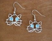 WHITE JAZZCAT EARRINGS wire wrapped white. $16.00, via Etsy.