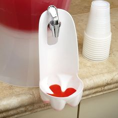 Use a 2 liter bottle to make a drip catcher for drink spouts.