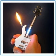 Mini Guitar LED Light Lighter Refillable Cigar Cigarette Lighter will get everyone's attention. Makes a perfect gift for smokers who likes music and cool lighters. Cool Lighters, Cigar Lighters, Light My Fire, Light Up, Cool Gadgets To Buy, Pipes And Bongs, Weed Pipes, Zippo Lighter, Cool Things To Buy