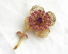 Hey, I found this really awesome Etsy listing at https://www.etsy.com/listing/234534070/vintage-gold-plated-1960s-brooch-flower