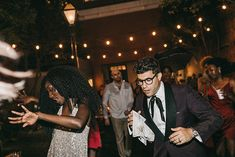 There Was Dancing in the Street—and the Rain—at This New Orleans Wedding Musicians Bridgette Amofah and Saul Bloch were married surrounded by greenery, brass bands, and 50 of their closest friends and family. Smoking Vintage, Preservation Hall Jazz Band, Second Line Parade, Velvet Dinner Jacket, Vintage Tuxedo, White Bridal Shoes, Groomsmen Tuxedos, Second Hand Wedding Dresses, Bridesman