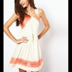 "New Free People Georgia Coral Lace Skater Dress New without tags. Free People Ivory with Neon coral lace detail Skater dress. ***SMALL MARK SEE PIC #2. SZ 0 Under armpit to under armpit 15"" Length from shoulder to end of dress 34"".  8"" Side zipper. Fully lined. T1 Free People Dresses Midi"