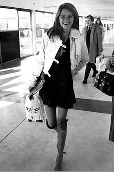 Charlotte Rampling wearing knee-high boots in London's Heathrow Airport, 1970, via Rue Des Archives
