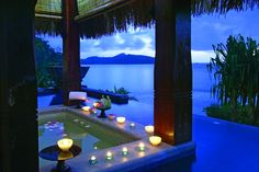 Maia Luxury Resort and Spa Seychelles - Hot tub surrounded by an infinity pool surrounded by the ocean.