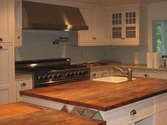 Reclaimed Hardwood Countertops courtesy of http://antiquewoodworks.com//countertops.shtml