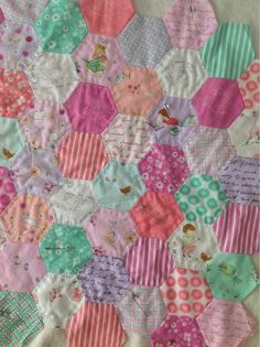 Hexies by Aneela Hoey from her own fabrics, on her blog Comfortstitching.  Beautiful!