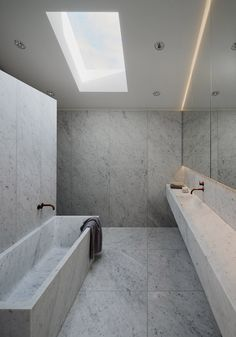 white marble bathroom. this sink is huge
