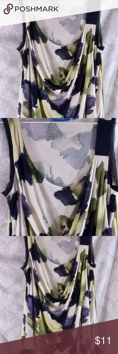 Vera Wang sleeveless wrap top M Vera Wang sleeveless wrap top M  Scoop top with criss cross layers across top  Floral Print  M Loose fit  100% Rayon  Hand Wash Cold                                                                       Pre Loved No defects, stains, tears…. Please let me know if you have any questions…. HAPPY to negotiate prices and encourage bundles!! Thank you for visiting my closet! Vera Wang Tops Blouses