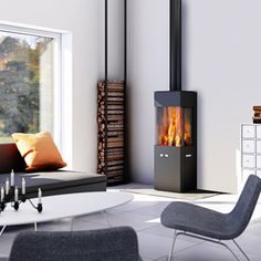 - Holz-kaminofen / modern / 3 sichtseiten / metall by RAIS Contemporary Wood Burning Stoves, Modern Stoves, Living Tv, Home And Living, Modern Living, Indoor Wood Stove, Freestanding Fireplace, Firewood Storage, Home Fireplace